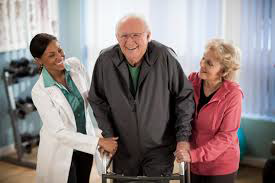 Nurses helping older man