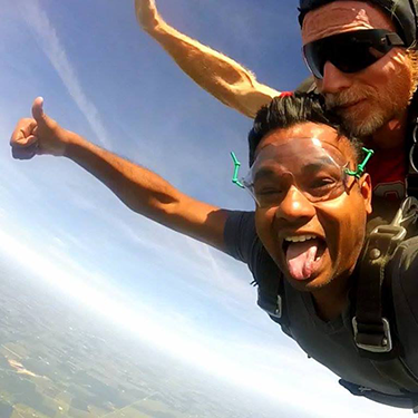 Dr. Praveen Venkatachalam and another person skydiving