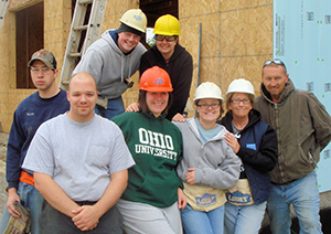 residents working at Habitat for Humanity