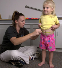 little girl being measured