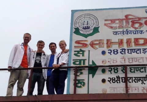 students standing next to sign in Sahid Kathmandu