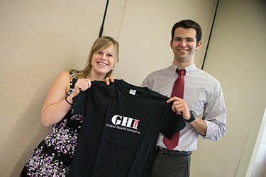 photo of two students holding a ghi tshirt