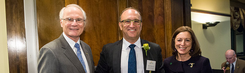President David Hopkins, 2014 award winner Louis A. Cannon, and Dean Marjorie Bowman