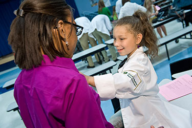photo of a medical student with a child