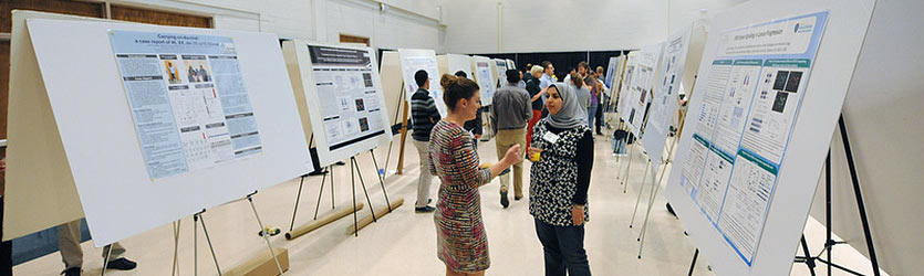 photo of students and posters at the 2014 forum