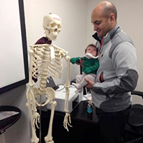 dad and baby looking at skeleton