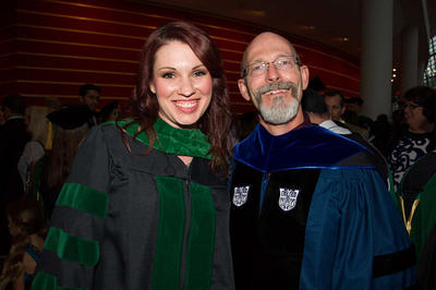 photo of a graduate and a professor