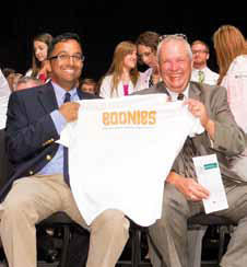 photo of parents holding Boonies shirt at convocation