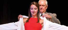 photo of student receiving white jacket at convocation