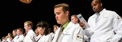 photo of students in white jackets