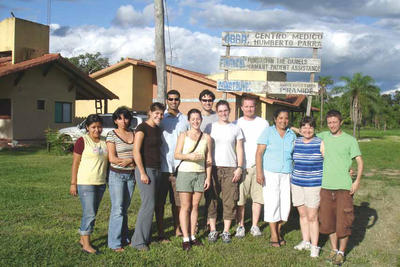 Photo of jan Duke with a group of students at a clinic in the Amazon River Basin in Bolivia.