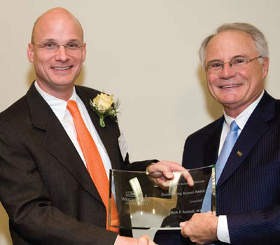 Photo of Mark Anstadt, M.D. ('86), receiving the 2009 Outstanding Alumni Award from Wright State University President David R. Hopkins, P.E.D.