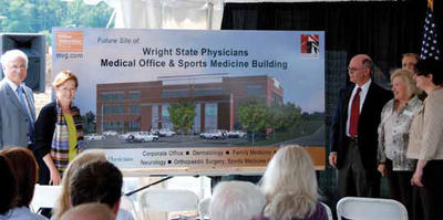 Photo of David R. Hopkins, president, Wright State University; Margaret Dunn, M.D.; Howard Part, M.D., dean, Boonshoft School of Medicine; Marilyn Reid, Greene County commissioner; Dr. Corey Ellis, M.D., assistant professor, orthopaedic surgery; and Cynthia Olsen, M.D., family medicine acting chair, unveil an artist rendering of the new Wright State Physicians building