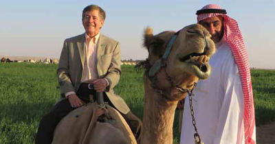 photo of physician and a camel in saudi arabia