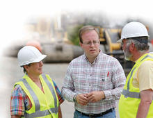photo of Nathan Schlicher with construction workers