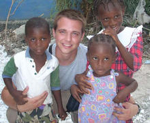 Photo - Undergraduate, second-year student Ryan Schmucker volunteering at a health clinic in rural Haiti.