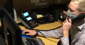 Boonshoft School of Medicine student answering phone, contact tracing