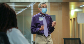 Boonshoft School of Medicine faculty teaching medicine with mask