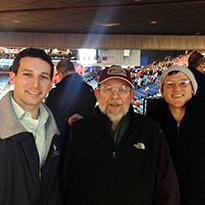 Dan and Rufus with Dr. Binski at a University of Dayton Basketball gam